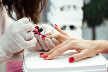 Young Woman Doing Manicure In ...