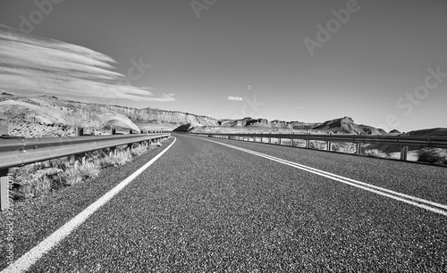 Canvas Prints Motor sports Black and white picture of an empty road, travel concept.
