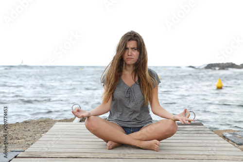Stressed girl trying to do yoga exercises Poster Mural XXL