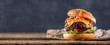 canvas print picture - Close-up home made beef burger on wooden table
