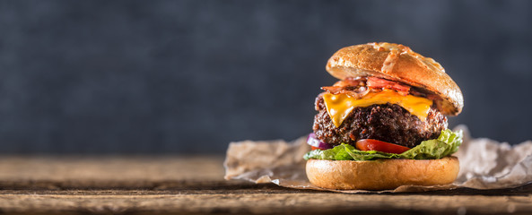 Fototapeta Close-up home made beef burger on wooden table