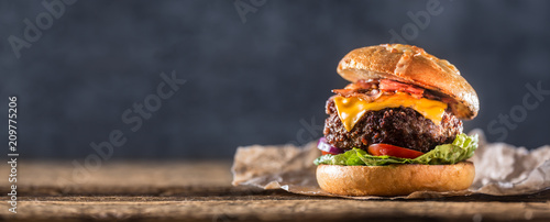 Tablou Canvas Close-up home made beef burger on wooden table