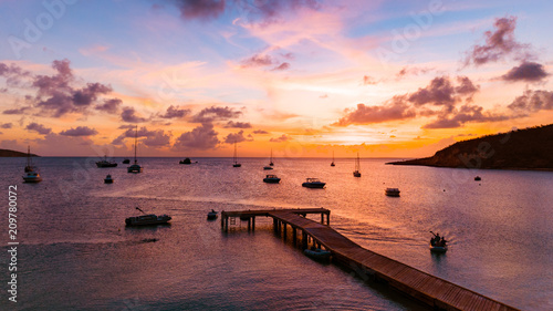 Tropical Sunset over Ocean Pier with Boats Canvas Print