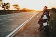 Man resting sitting on motorbike at roadside