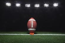 Football On A Tee At Night Und...