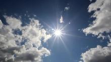 Shiny Sun Shining Over Blue Sk...