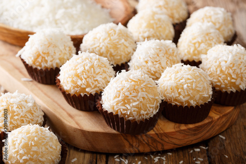 Foto op Aluminium Snoepjes Brazilian coconut kisses (beijinhos de coco are traditionally made from a mixture of sweetened condensed milk, coconut flakes, and butter