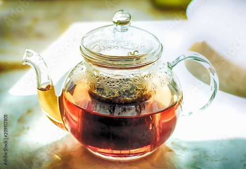 Staande foto Thee glass teapot for tea with hot herbal tea. Hot wholesome tea. a cure for the flu