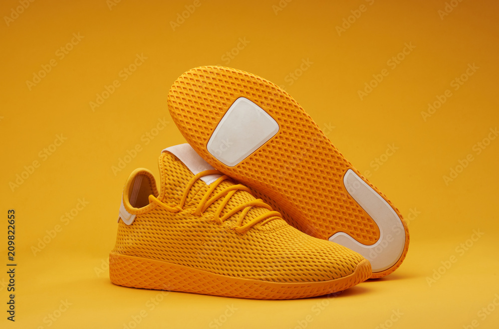 Fototapeta Sport shoes theme in yellow color
