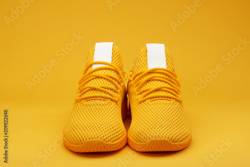 Photo Front view of sport yellow  pair shoes