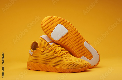 Fotografía Sport shoes theme in yellow color