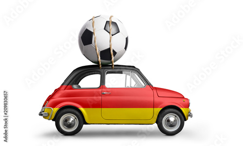 Germany flag on car delivering soccer or football ball isolated on white background