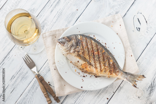 Grilled gilt-head bream on the plate