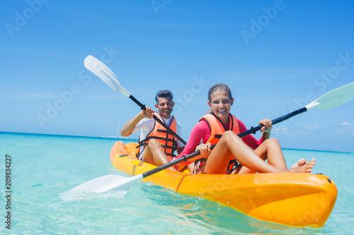 Happy girl and her father kayaking at tropical sea on yellow kayak Tapéta, Fotótapéta