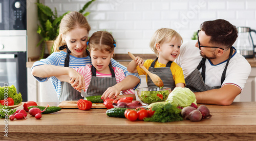Poster Cuisine appy family with child preparing vegetable salad