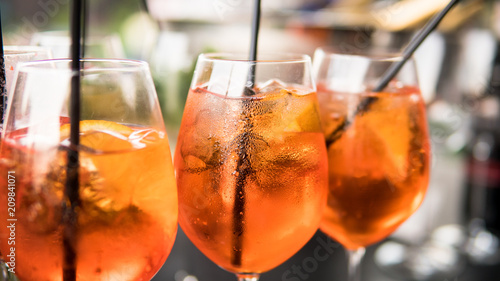 Photo .summer citrus cold alcohol drink Aperol Spritz close-up