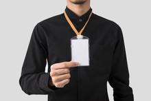 Employee Hand Showing Blank Id Card Badge Holder For Mockup Template Logo Branding Background.