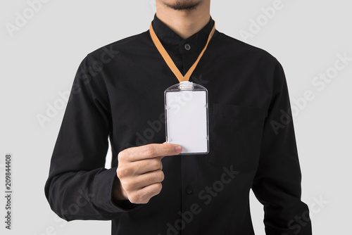 Photo employee hand showing blank id card badge holder for mockup template logo branding background