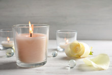 Beautiful Composition With Burning Wax Candle On Table