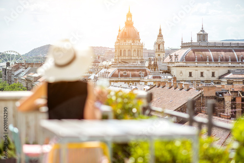Foto auf Leinwand Budapest Woman enjoying great cityscape view from the terrace on the old town with saint Stephen cathedral in Budapest city, Hungary. Woman is out of focus