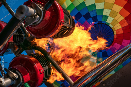 Poster Montgolfière / Dirigeable Hot air balloon, bright burning fire flame from gas burner equipment, close up from inside