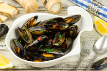 Mussels In Wine Served With Parsley And Lemon. Seafood. Clams In The Shells. Delicacy For Gourmands.