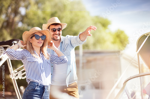 loving couple having fun together at a yacht club in the summer