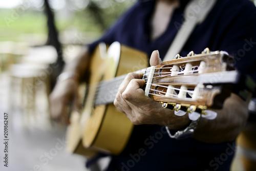 Fototapety Muzyka closeup-detail-hand-playing-folk-guitar-outdoor-summer-festival