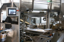 Industrial Line For Packaging Of Bakery Products. Packing Of Bread At The Factory.The Machine For Cutting And Packing In A Factory For The Production Of Bread.