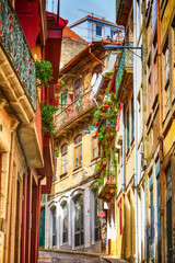 Fototapeta Architektura Porto, Portugal old town narrow street perspective view with colorful traditional houses