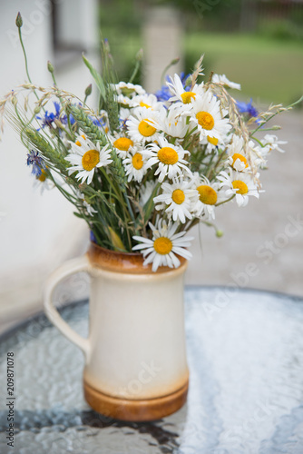 Fototapety, obrazy: Midsummer in Latvia: celebration of Ligo in june decorating home with field flower bouquet