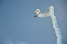 A Stunt Plane Performance At An Air Show.
