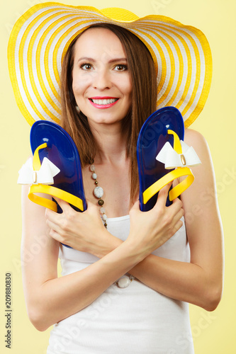 Woman In Big Yellow Summer Hat Holds Flip Flops Buy This Stock
