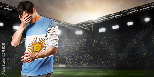 Fotografía Argentina national team. Sad soccer or football player on stadium