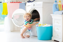 Child In Laundry Room With Was...