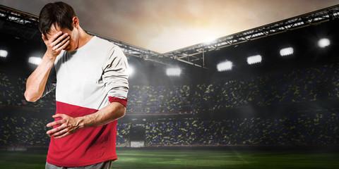 Fototapeta Poland national team. Sad soccer or football player on stadium