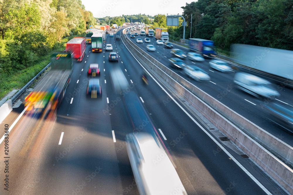 Fototapety, obrazy: Sunset view heavy traffic moving at speed on UK motorway in England
