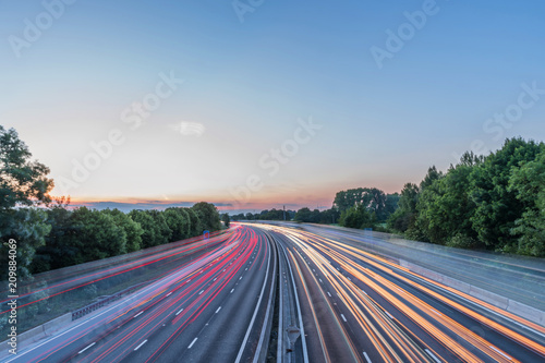 Fotografía Sunset view heavy traffic moving at speed on UK motorway in England