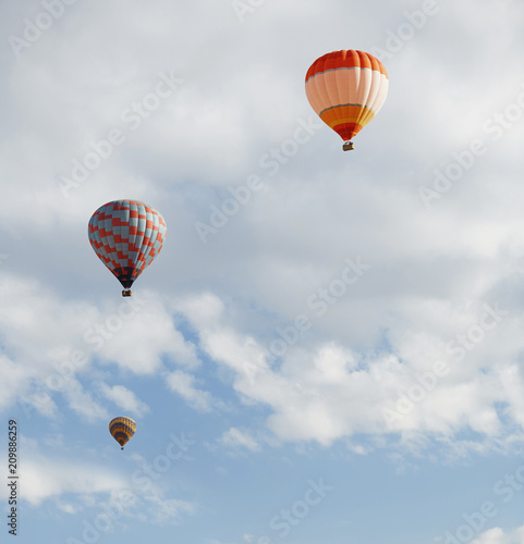 Three air balloons flying in the sky