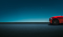 Sport Car Parked On Road Side With Night Sky Background .