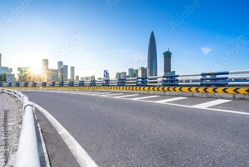 Poster Pekin asphalt road with city skyline
