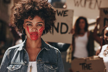 Activist Demonstrating To Stop...