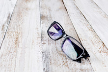 Black Glasses On Wooden Backgr...