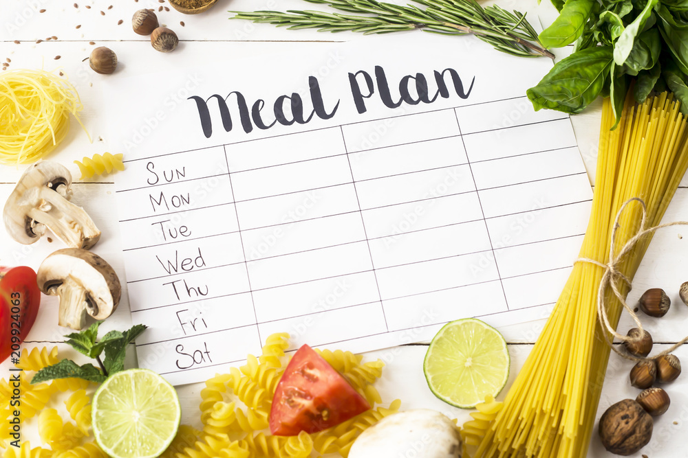 Fototapety, obrazy: A meal plan for a week on a white table among products for cooking - pastas, basil, vegetables, lime, seeds, nuts and spices. Top view, flat lay, copyspace