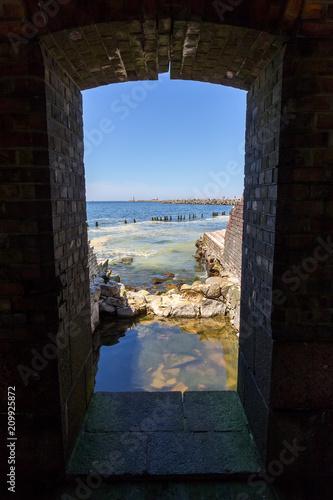 Foto op Plexiglas Cyprus Ruins of the old fortification on the Baltic seashore.