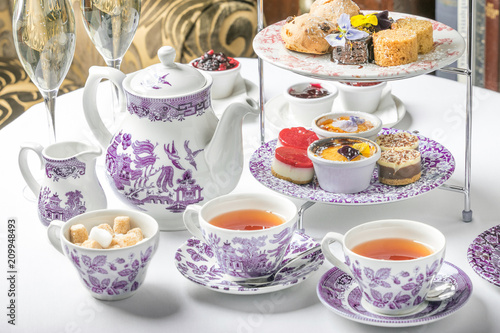 Fototapeta old school style tea at five afternoon service sandwich set cake sweet traditional table hotel cheesecake sugar pot china cup obraz