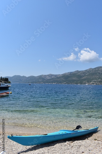 Fotografie, Obraz  Kayak on a Korcula beach with blue sky and sea background, Korcula Town, Korcula
