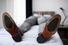 Exhausted Businessman Laying O...