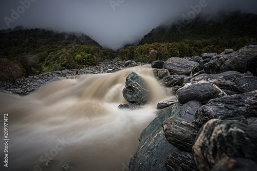Photographie  Long exposure of fast moving stream at Fox Glacier, South Island, New Zealand