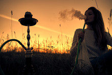 Silhouette Of A Girl Exhales S...
